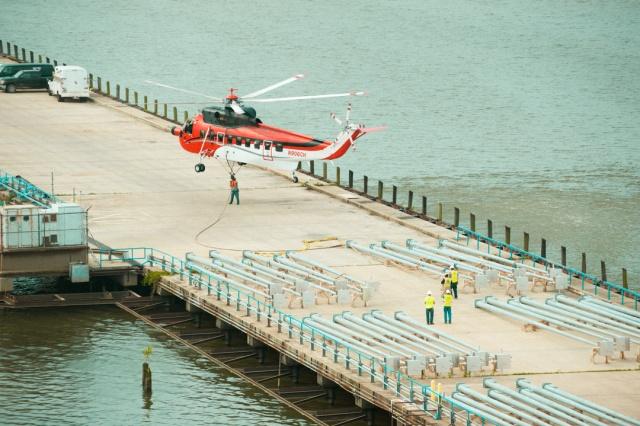 ulliman schutte construction, helicopter places light posts at blue plains